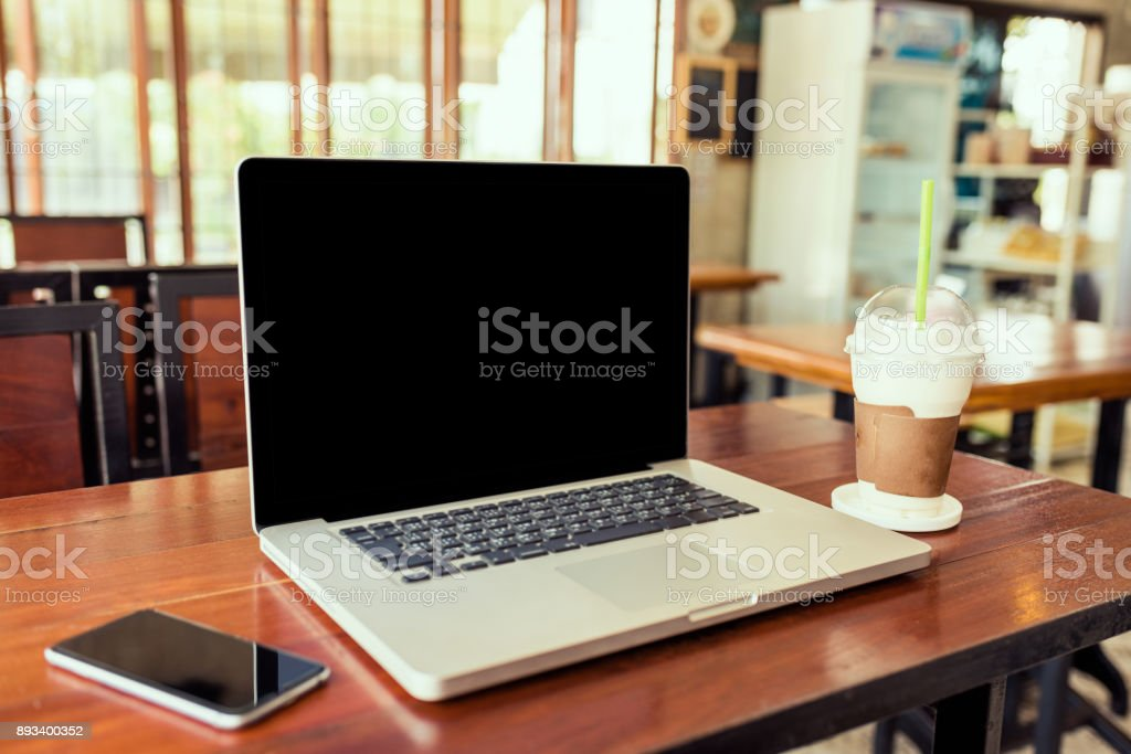Laptop computer black screen on wood table stock photo