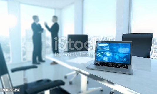 801895196istockphoto Laptop computer on office desk with business men 538148029