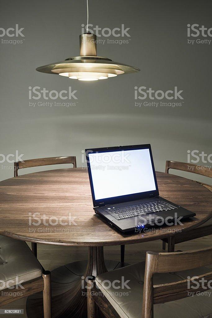 Laptop computer on table royaltyfri bildbanksbilder