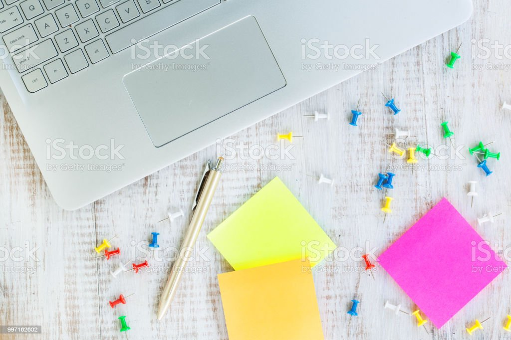 Laptop Computer On White Wood Office Work Desk With Paper and Pen stock photo