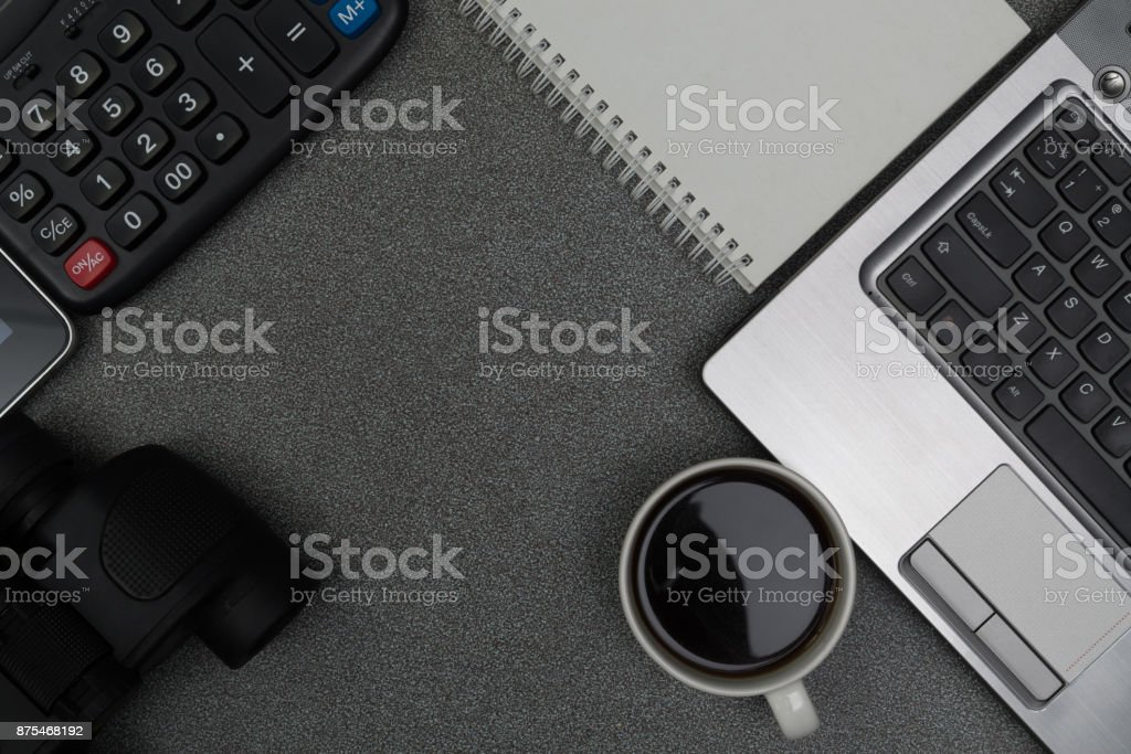 Laptop computer or notebook and other device, calculator and cup of coffee on working table with copy space top view. stock photo