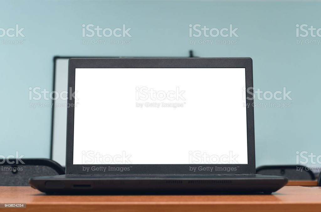 laptop computer pc with blank screen on the classroom background