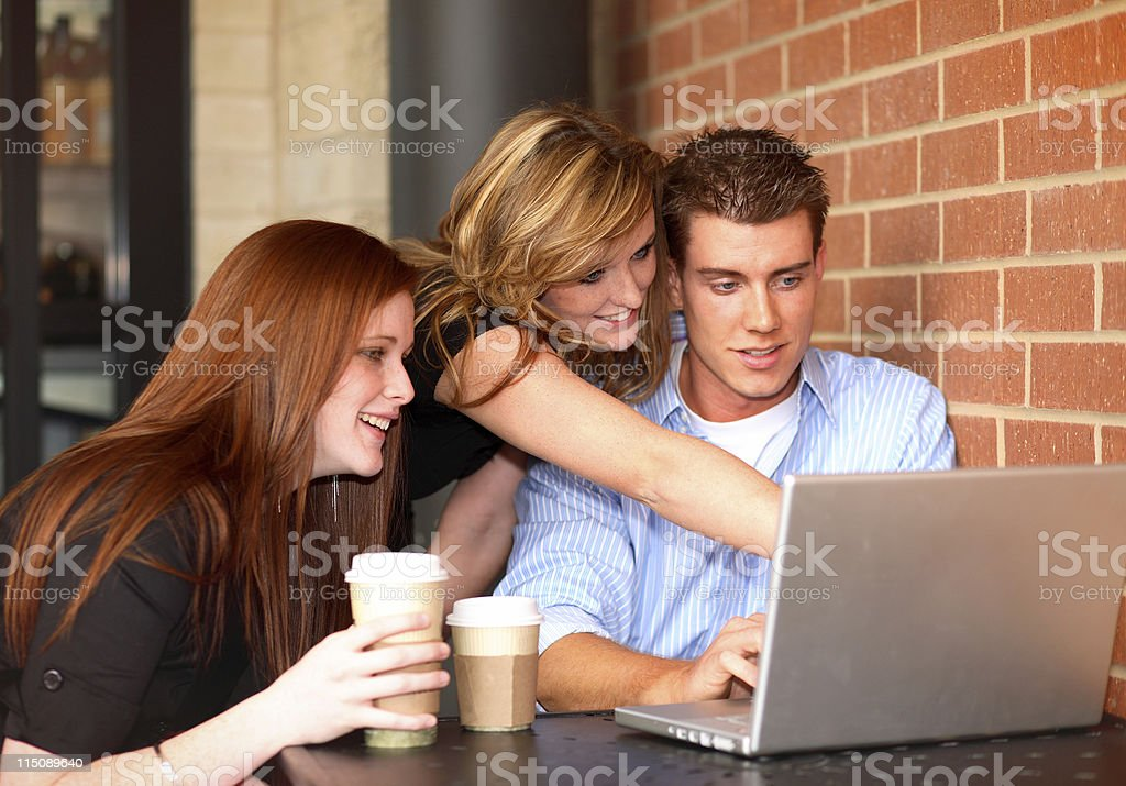 laptop computer scene - teen women young adult male royalty-free stock photo