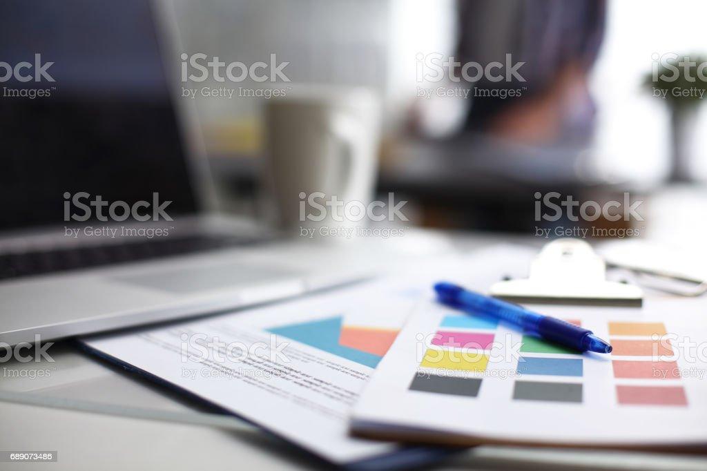 Laptop computer with folder on desk stock photo
