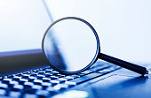 istock Laptop computer with magnifying glass, concept of search 1176754076