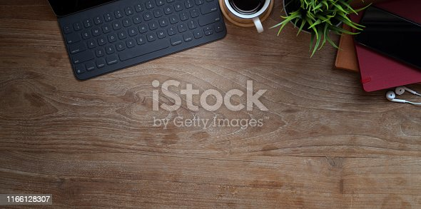 Top view of laptop computer with office accessories on wooden table with copy space