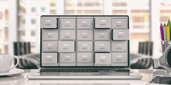 Computer data storage concept. Filing cabinet on a laptop screen. 3d illustration