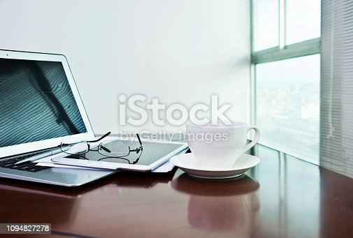 859186006 istock photo Laptop, digital tablet and coffee cup on table 1094827278