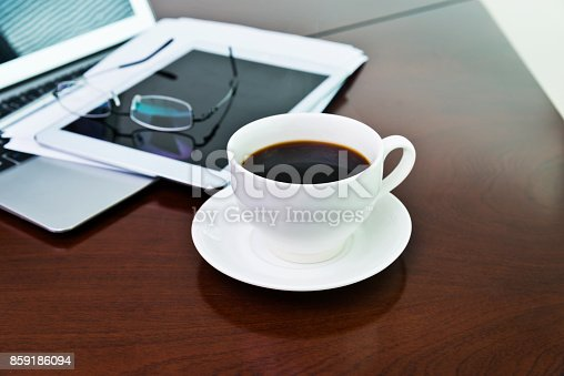 859186006 istock photo Laptop, digital tablet and coffee cup on table 859186094