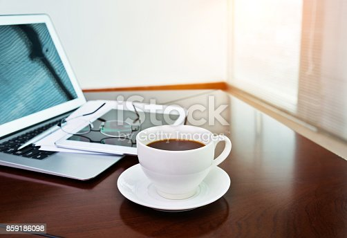 859186006 istock photo Laptop, digital tablet and coffee cup on table 859186098