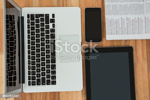 istock Laptop, digital tablet, mobile phone, and newspaper 650251342