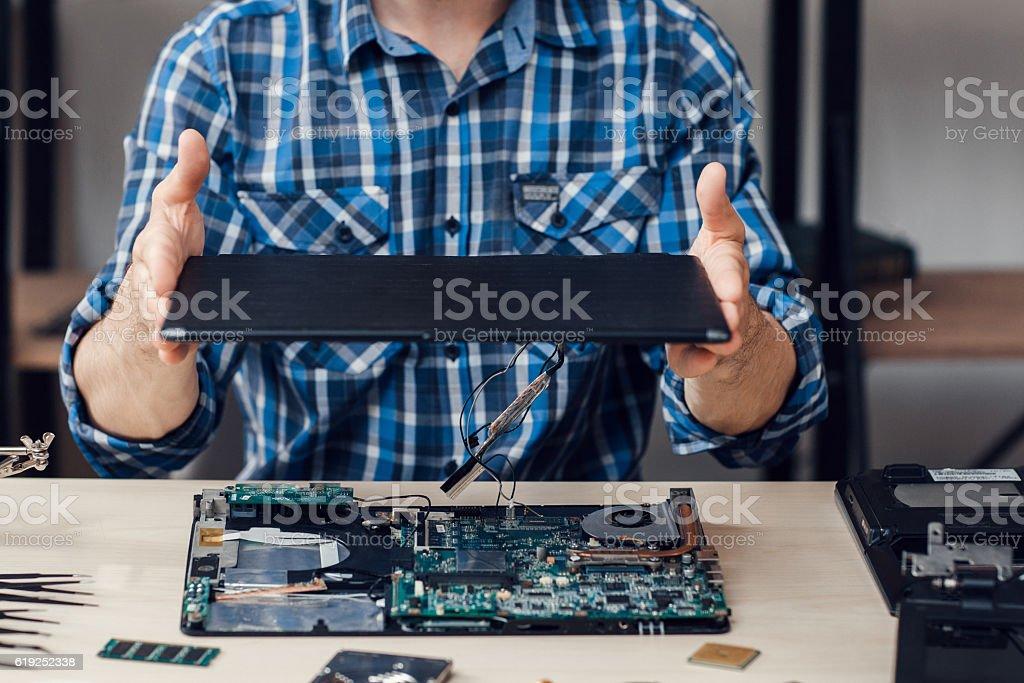 Laptop disassembling at electronic repair shop stock photo