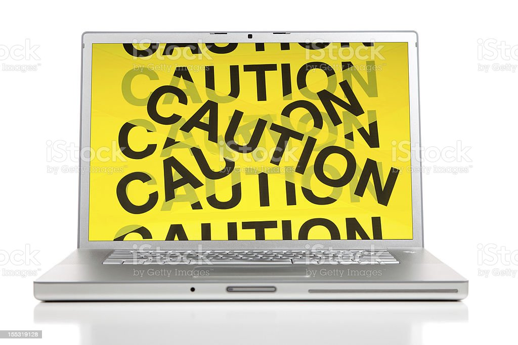 Laptop displaying a yellow caution sign royalty-free stock photo