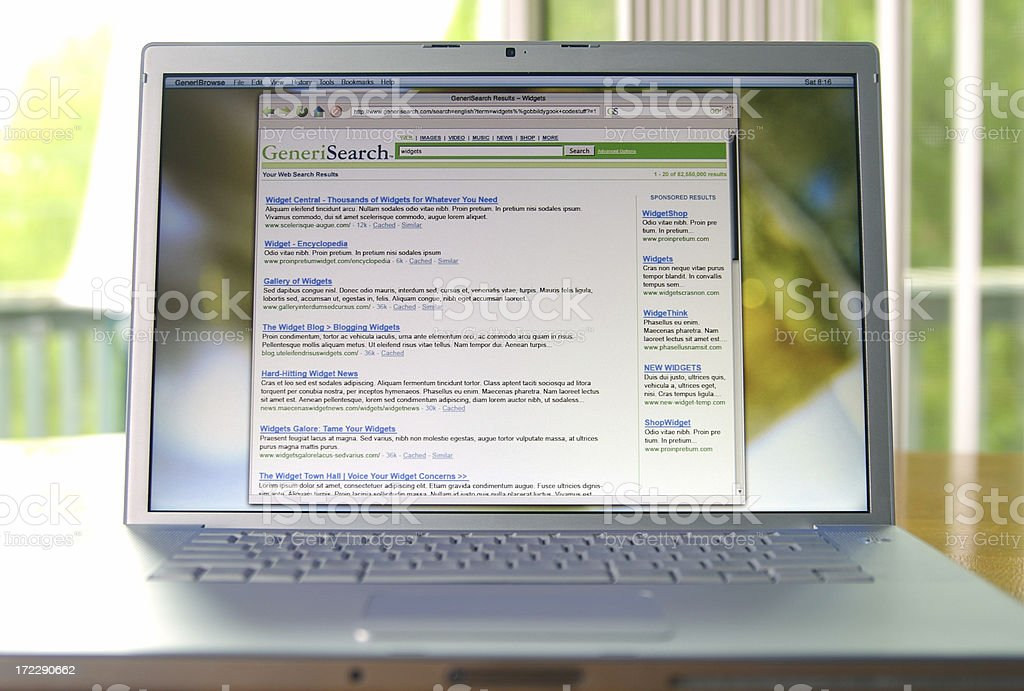 A laptop displaying search engine results stock photo