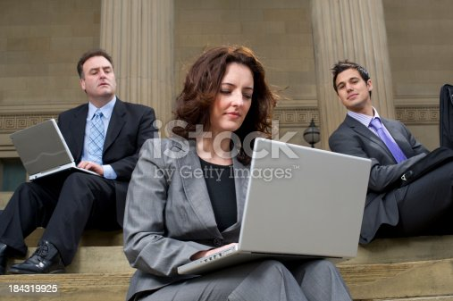 male office workers spy on female colleagues laptop
