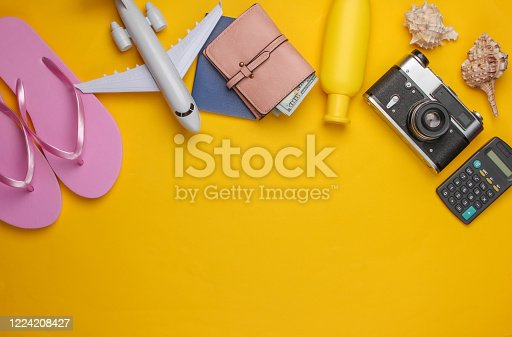 941183588 istock photo Laptop, glasses, calculator on a black background. Top view. 1224208427