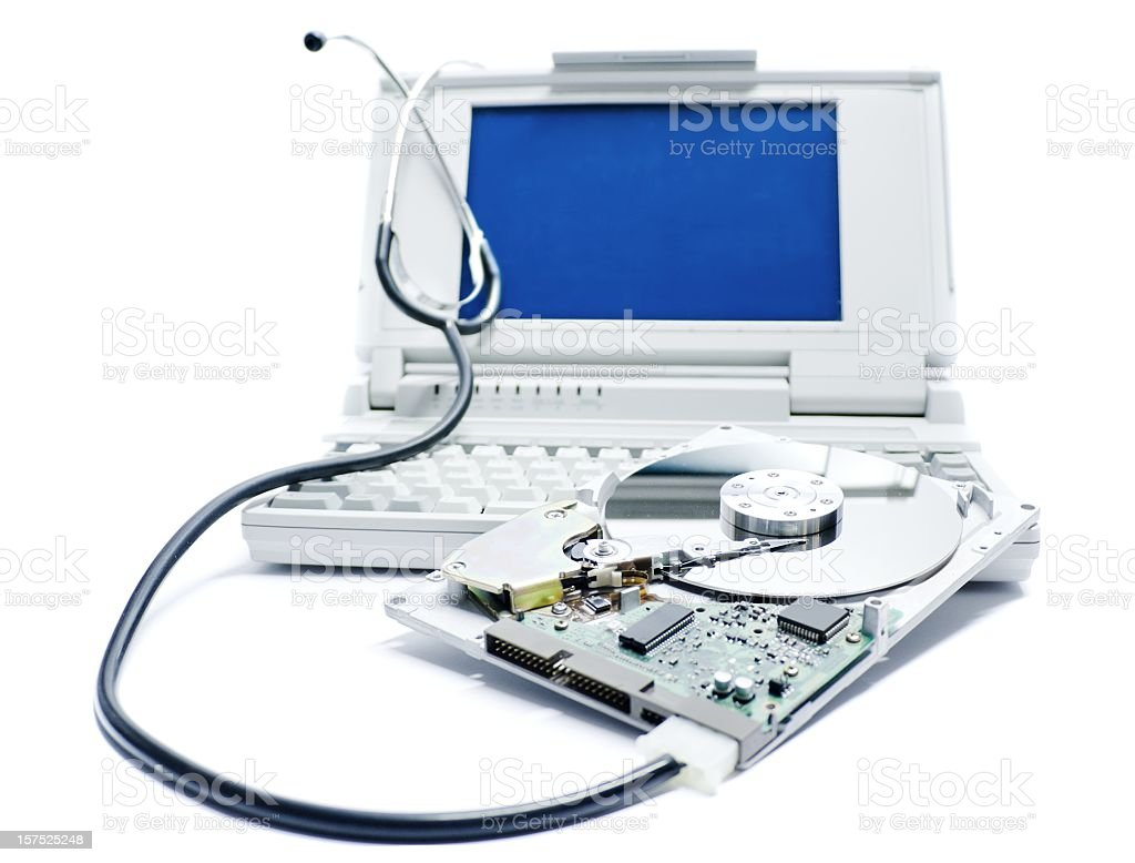 A laptop hard drive being repaired stock photo