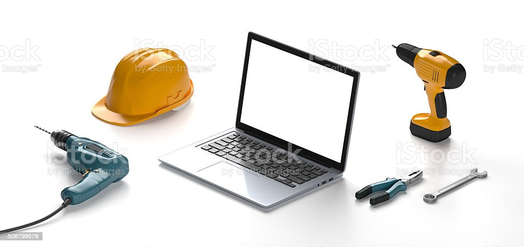 laptop, helmet, drill and construction tools stock photo