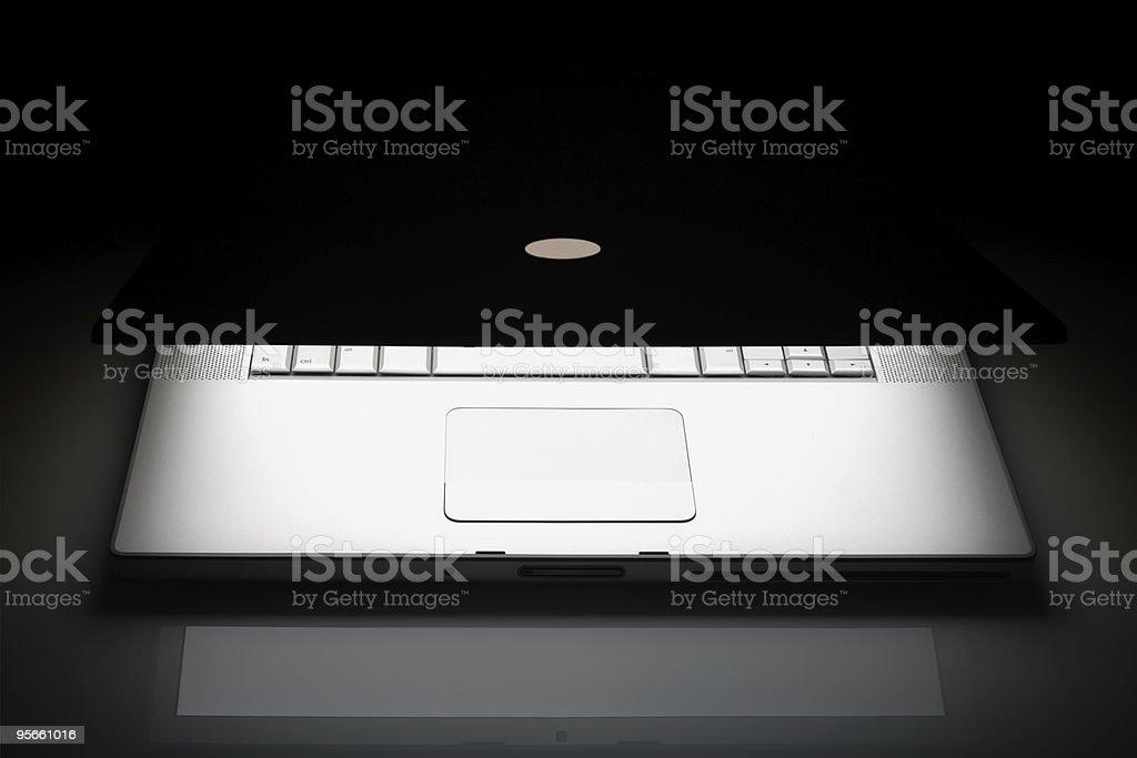 Laptop in dark royalty-free stock photo
