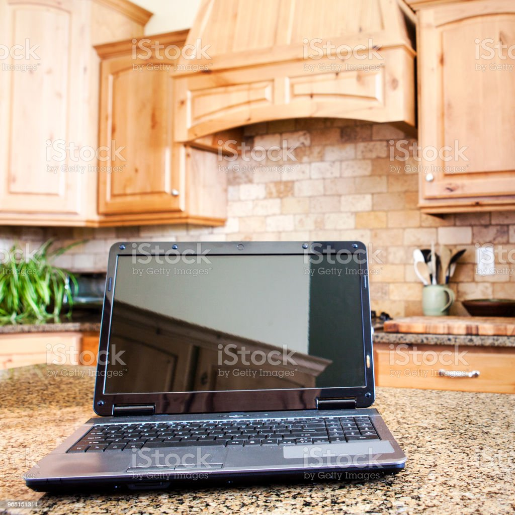 Laptop in Domestic Kitchen zbiór zdjęć royalty-free