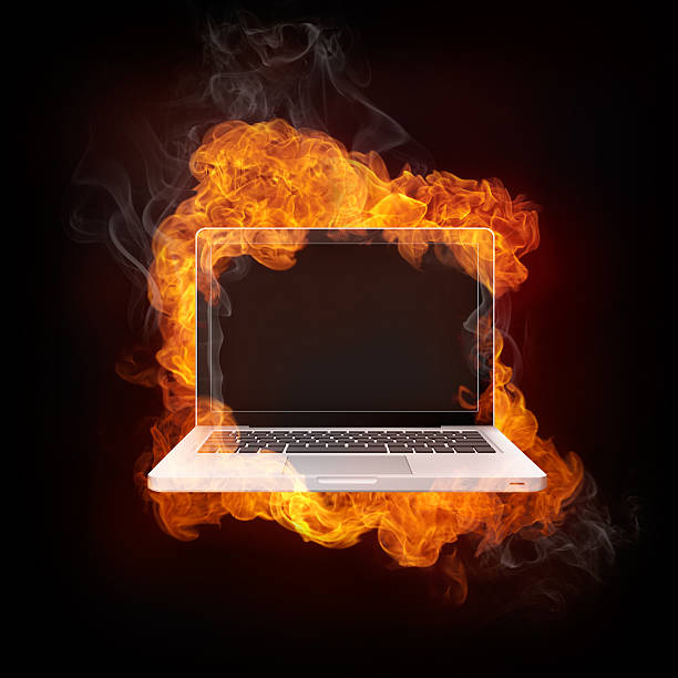 Laptop in Fire stock photo