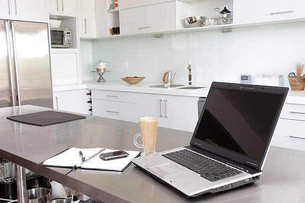 Laptop in Kitchen stock photo