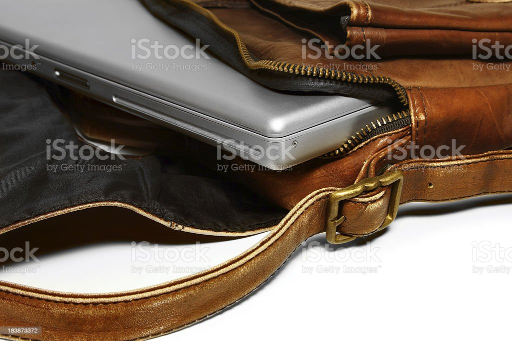 Laptop in leather bag stock photo