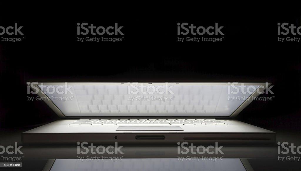 Laptop in low key stock photo