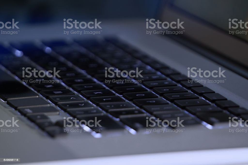 Laptop keyboard in the dark stock photo