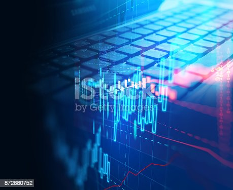 istock laptop keyboard on technology financial graph background. 872680752