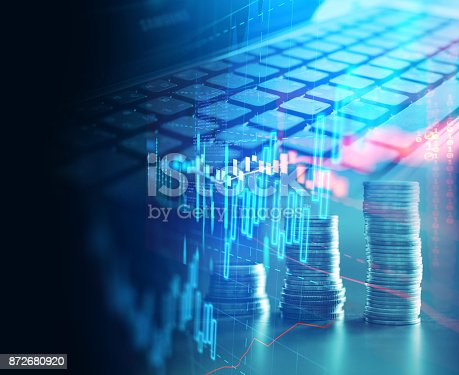 istock laptop keyboard on technology financial graph background. 872680920