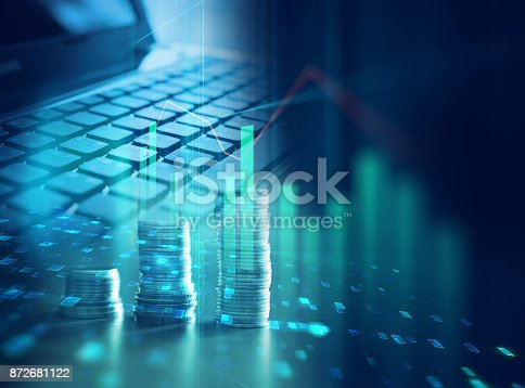 istock laptop keyboard on technology financial graph background. 872681122