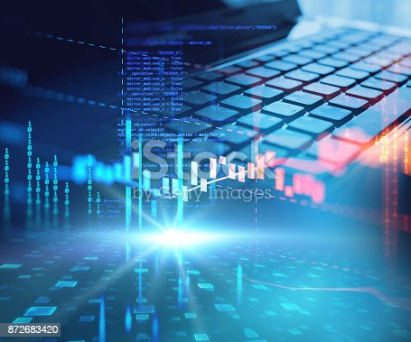 istock laptop keyboard on technology financial graph background. 872683420