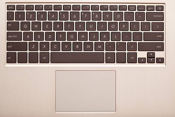 Laptop keyboard. Close up on laptop keyboard (top view). touchpad stock pictures, royalty-free photos & images