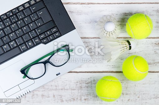 istock laptop, laptop, Sports Equipment, Tennis ball and Shuttlecock 615991320