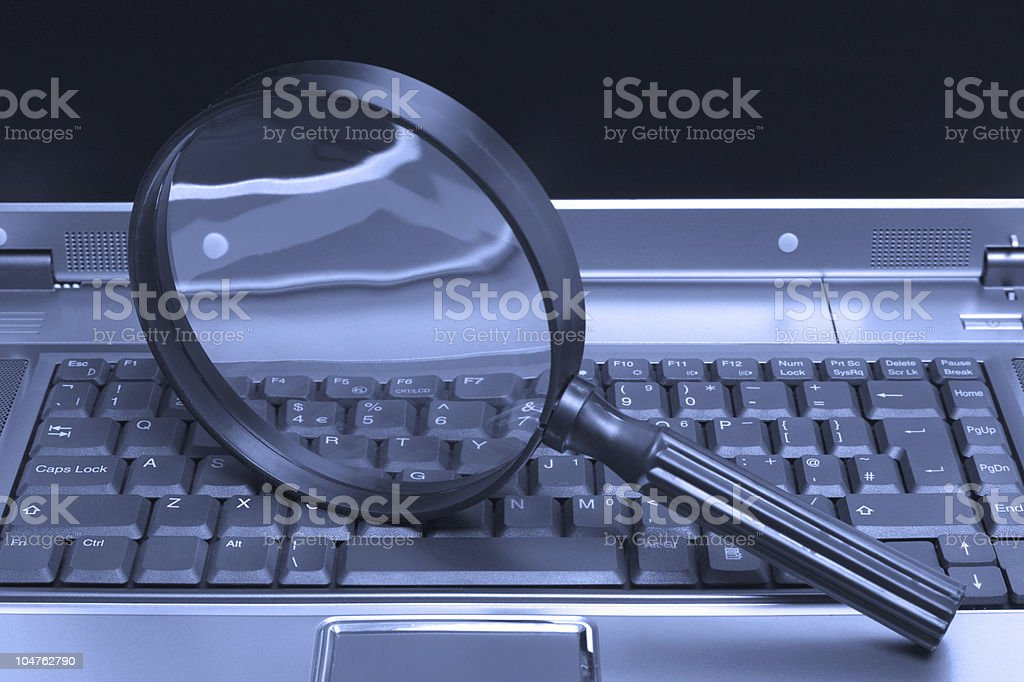 Laptop Magnifying glass royalty-free stock photo