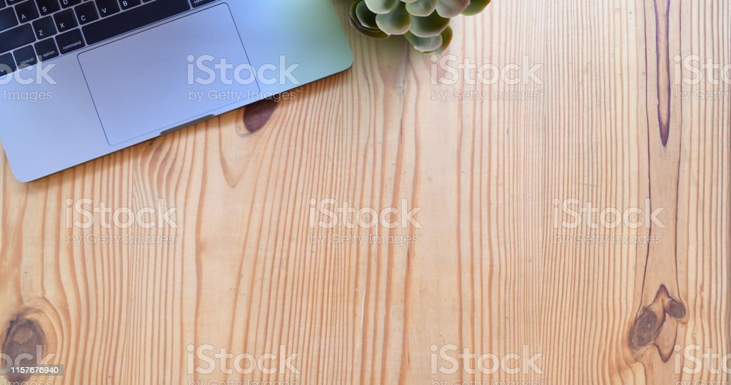 Laptop mock up on wood desk and copy space