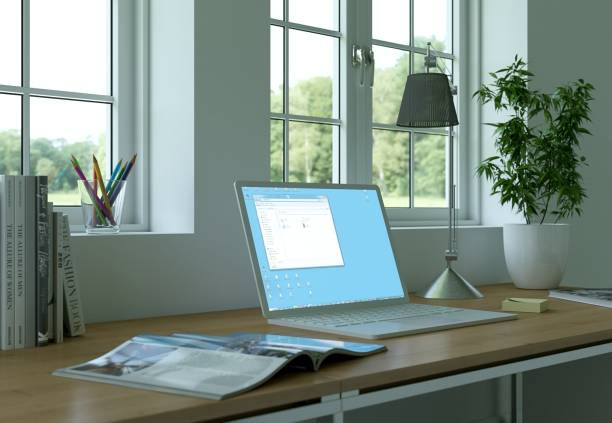 laptop mock-up illuminated screen stands on the office desk - green screen background stock photos and pictures