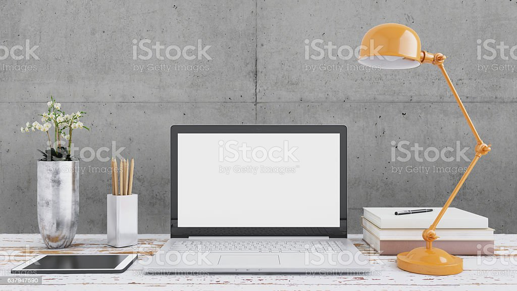 Laptop monitor on an office desk stock photo