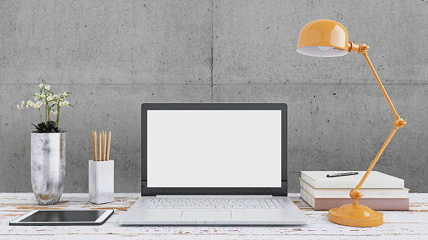 laptop monitor on an office desk - desk stock photos and pictures