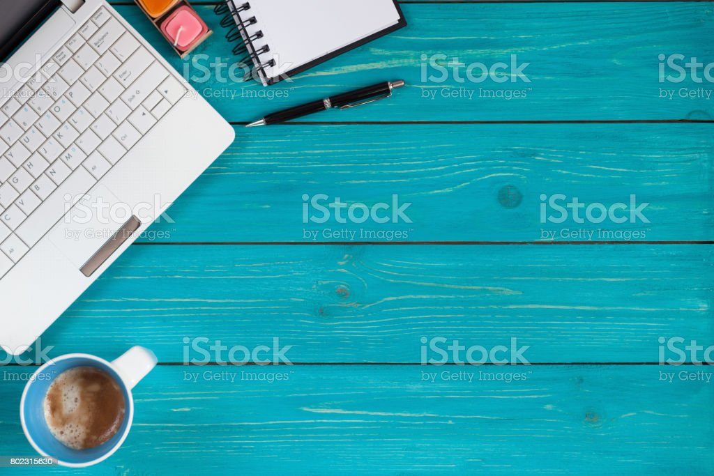 Laptop, notebook, pencil and cup of coffee on wooden background with space for text stock photo