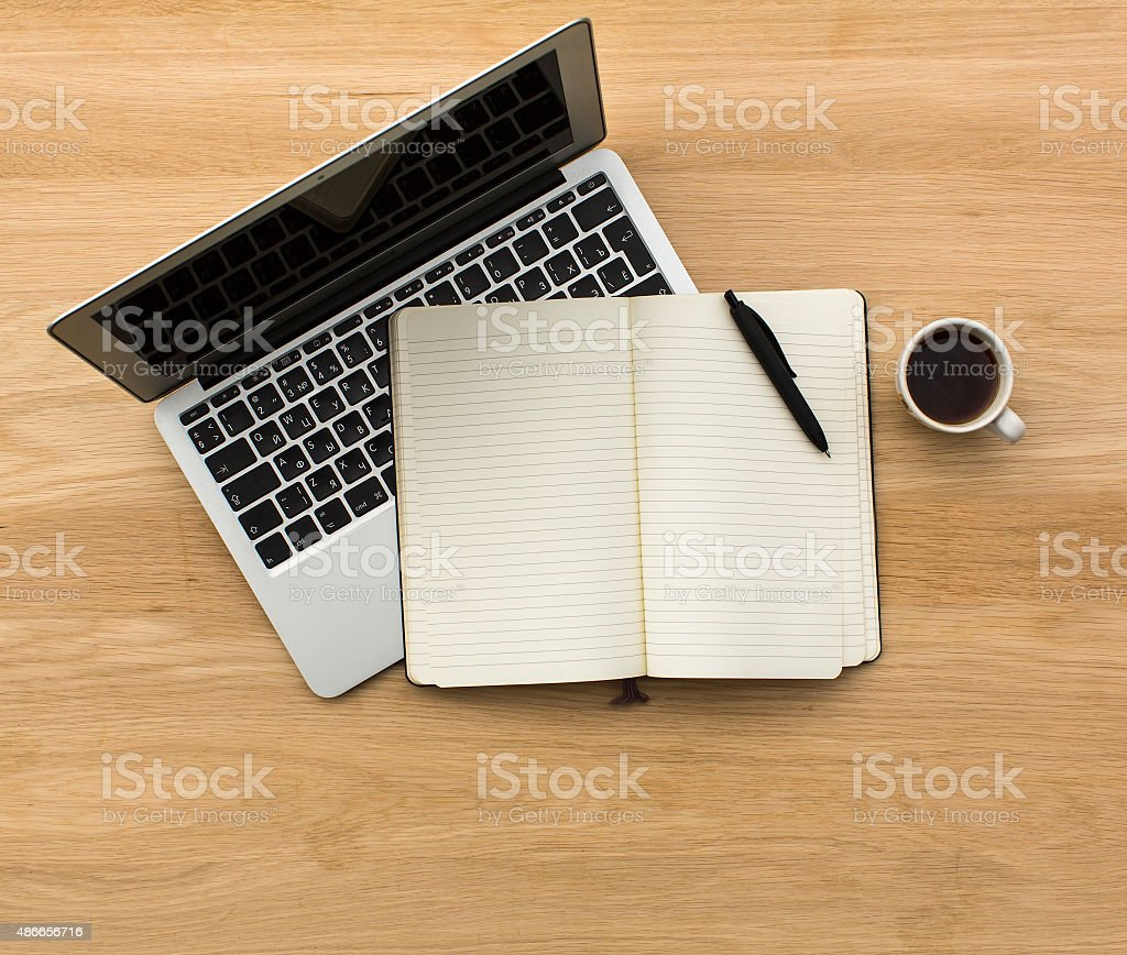 Laptop, Notepad and to view on wooden table texture stock photo