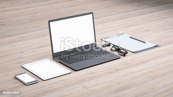 istock Laptop on a desk with accessories, blank screen mock-up isometric 949542632
