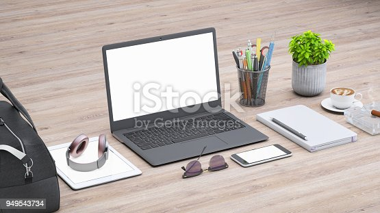 istock Laptop on a desk with accessories, blank screen mock-up isometric 949543734