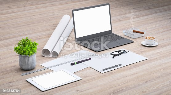 949542094 istock photo Laptop on a desk with accessories, blank screen mock-up isometric 949543764