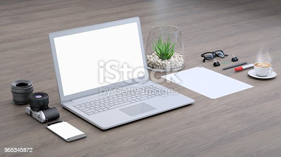 istock Laptop on a desk with accessories, blank screen mock-up isometric 955345872
