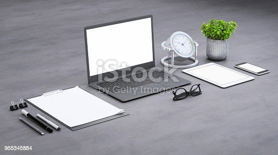 istock Laptop on a desk with accessories, blank screen mock-up isometric 955345884