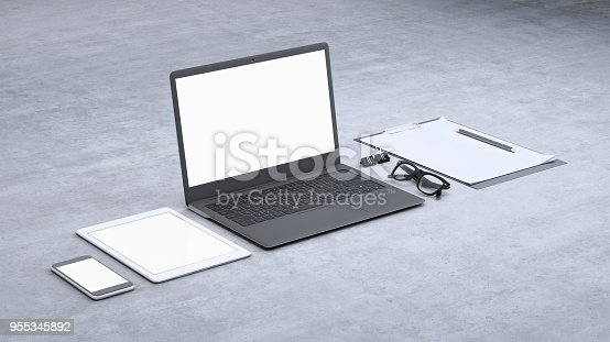 istock Laptop on a desk with accessories, blank screen mock-up isometric 955345892