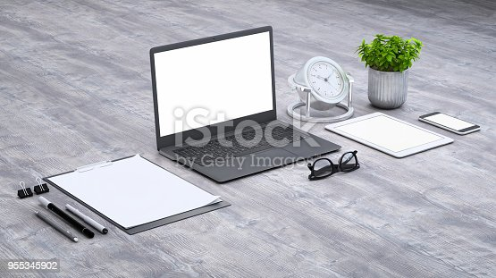 istock Laptop on a desk with accessories, blank screen mock-up isometric 955345902