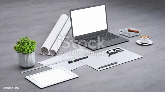 istock Laptop on a desk with accessories, blank screen mock-up isometric 955345950